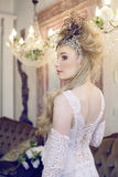 Beauty blond emotional bride in luxury white Royalty Free Stock Photography