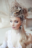 Beauty blond emotional bride in luxury white Stock Images
