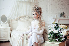 Beauty blond emotional bride in luxury white Stock Photo