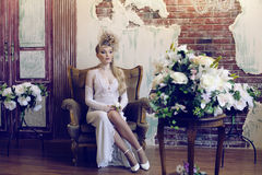 Beauty blond emotional bride in luxury white Royalty Free Stock Photo