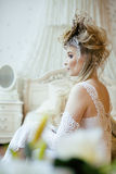 Beauty blond emotional bride in luxury white Royalty Free Stock Image