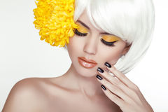 Beauty Blond Female Portrait with yellow flowers. Beautiful Spa Stock Photography