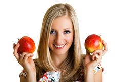 Beauty blond girl with apple Royalty Free Stock Photos
