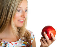 Beauty blond girl with apple Royalty Free Stock Photo