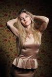 Beauty blond girl in beige dress Stock Photo