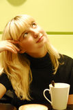 Beauty blond girl drinking coffee Stock Images