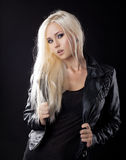 Beauty blond girl in leather jacket Royalty Free Stock Images