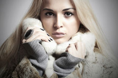 Beauty blond Model Girl in Mink Fur Coat.Beautiful Woman Royalty Free Stock Images