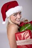 Beauty Blond Santa. Beautiful Blond Girl Holding A Lot Of Christmas Presents Stock Photography