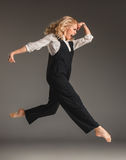 Beauty blond woman in ballet jump Stock Photos