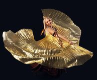 Beauty blond woman dance with flying gold wing Stock Images