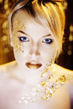 Beauty blond woman with gold creative make up Royalty Free Stock Image
