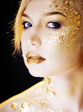Beauty blond woman with gold creative make up, bokeh on yellow background Royalty Free Stock Image