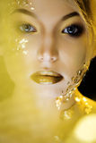 Beauty blond woman with gold creative make up Stock Photos