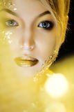 Beauty blond woman with gold creative make up Stock Images