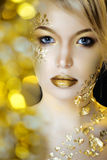 Beauty blond woman with gold creative make up royalty free stock photos