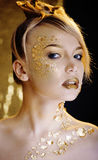 Beauty blond woman with gold creative make up Stock Photo