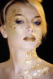 Beauty blond woman with gold creative make up Stock Photography