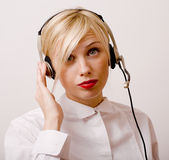 Beauty blond woman with headphones, call operator Royalty Free Stock Images