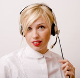 Beauty blond woman with headphones, call operator Royalty Free Stock Image
