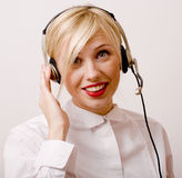 Beauty blond woman with headphones, call operator Stock Photos
