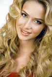 Beauty blond woman with long curly hair close up Stock Images