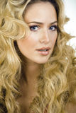 Beauty blond woman with long curly hair close up Royalty Free Stock Photo