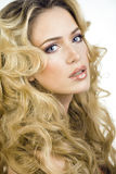 Beauty blond woman with long curly hair close up Stock Photos