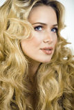 Beauty blond woman with long curly hair close up Royalty Free Stock Image
