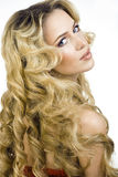 Beauty blond woman with long curly hair close up Royalty Free Stock Photos