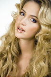 Beauty blond woman with long curly hair close up Stock Photo