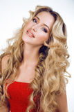 Beauty blond woman with long curly hair close up isolated, hairstyle waves hollywood, smiling happy lifestyle people Royalty Free Stock Images