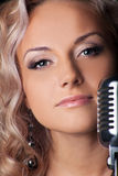 Beauty blond woman portrait with microphone Stock Photo