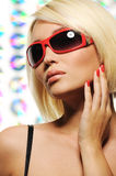 Beauty blond woman in red fashion sunglasses Royalty Free Stock Image