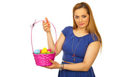 Beauty blond woman showing Easter basket Royalty Free Stock Photography