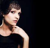 Beauty blond woman in studio on black background, stylish fashio Royalty Free Stock Photo