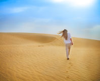 Beauty blond woman walking in Sahara desert. Tunisia. Stock Images