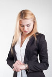 Beauty blond worried female manager is checking the time Royalty Free Stock Photography