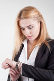 Beauty blond worried female manager is checking the time Royalty Free Stock Image