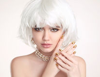 Beauty Blonde. Blond bob hairstyle. Manicured nails. Fashion gir Stock Photos