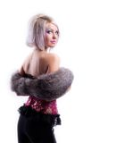 Beauty blonde in corset and fur boa look at you Stock Image