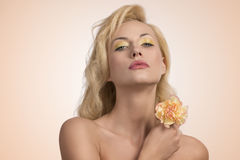 Beauty blonde girl with flower Royalty Free Stock Photography