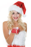 Beauty blonde girl in santa hat with gift Stock Photo