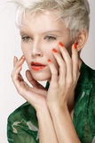 Beauty blonde model hairstyle perfect makeup and manicure Stock Images