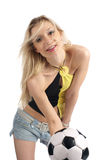 Beauty blonde with soccer ball Royalty Free Stock Image