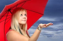 Beauty blonde with umbrella. Royalty Free Stock Photography