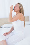 Beauty blonde using asthma inhaler Stock Image