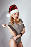 Beauty blonde woman as Santa Claus Stock Photos