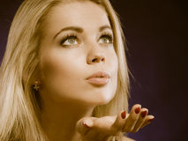 Beauty blonde woman blowing kiss Stock Photography