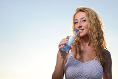 Beauty blonde woman with bottle of water Royalty Free Stock Photos